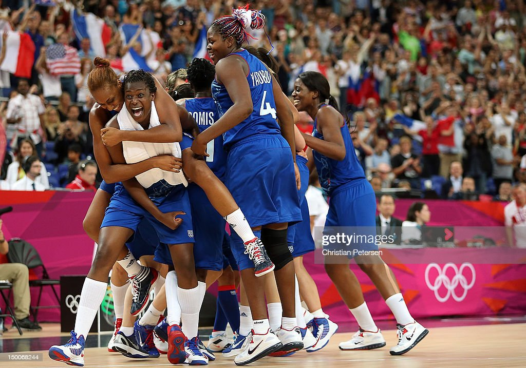 Endene Miyem #5 (L) of France celebrates with <a gi-track='captionPersonalityLinkClicked' href=/galleries/search?phrase=Sandrine+Gruda&family=editorial&specificpeople=711208 ng-click='$event.stopPropagation()'>Sandrine Gruda</a> #7 on her back after defeating Russia 81-64 in the Women's Basketball semifinal on Day 13 of the London 2012 Olympics Games at North Greenwich Arena on August 9, 2012 in London, England.