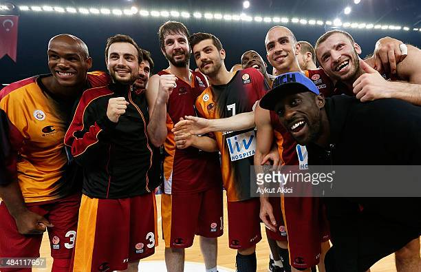 Ender Arslan #33 of Galatasaray Liv Hospital Istanbul celebrate victory during the 20132014 Turkish Airlines Euroleague Top 16 Date 14 game between...