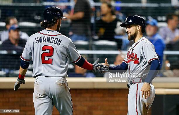 Ender Inciarte and Dansby Swanson of the Atlanta Braves react after both scored in the fourth inning against the New York Mets after a double from...
