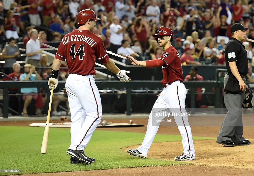 Ender Inciarte and teammate Paul Goldschmidt of the Arizona Diamondbacks celebrate scoring a sixth inning run against the Chicago Cubs at Chase Field...