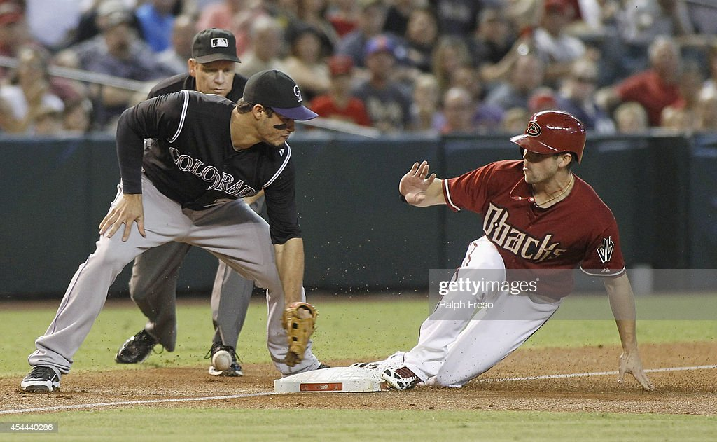 Ender Inciarte #5 of the Arizona Diamondbacks advances to third base safely on a wild pitch as <a gi-track='captionPersonalityLinkClicked' href=/galleries/search?phrase=Nolan+Arenado&family=editorial&specificpeople=7934273 ng-click='$event.stopPropagation()'>Nolan Arenado</a> #28 of the Colorado Rockies can't handle the throw during the first inning of a MLB game at Chase Field on August 31, 2014 in Phoenix, Arizona.