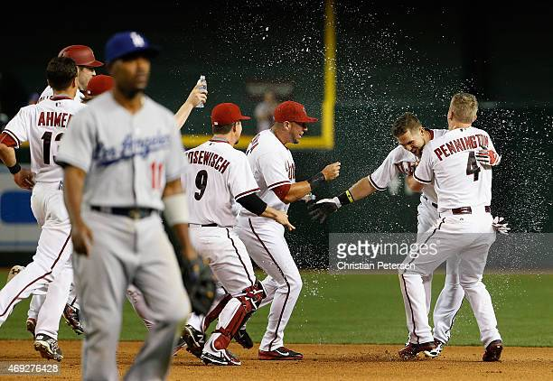 Ender Inciarte of the Arizona Diamondbacks is congratulated by David Peralta and Cliff Pennington after Inciarte hit a walk off RBI single against...