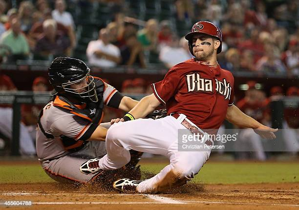 Ender Inciarte of the Arizona Diamondbacks is tagged out at home plate by catcher Andrew Susac of the San Francisco Giants during the first inning of...