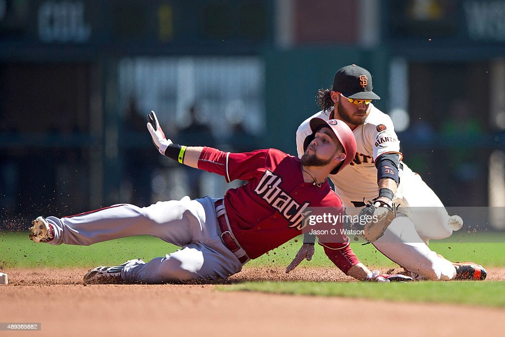 Ender Inciarte #5 of the Arizona Diamondbacks slides into second base for a double ahead of the tag of <a gi-track='captionPersonalityLinkClicked' href=/galleries/search?phrase=Brandon+Crawford&family=editorial&specificpeople=5580312 ng-click='$event.stopPropagation()'>Brandon Crawford</a> of the San Francisco Giants during the fourth inning at AT&T Park on September 20, 2015 in San Francisco, California. The San Francisco Giants defeated the Arizona Diamondbacks 5-1.