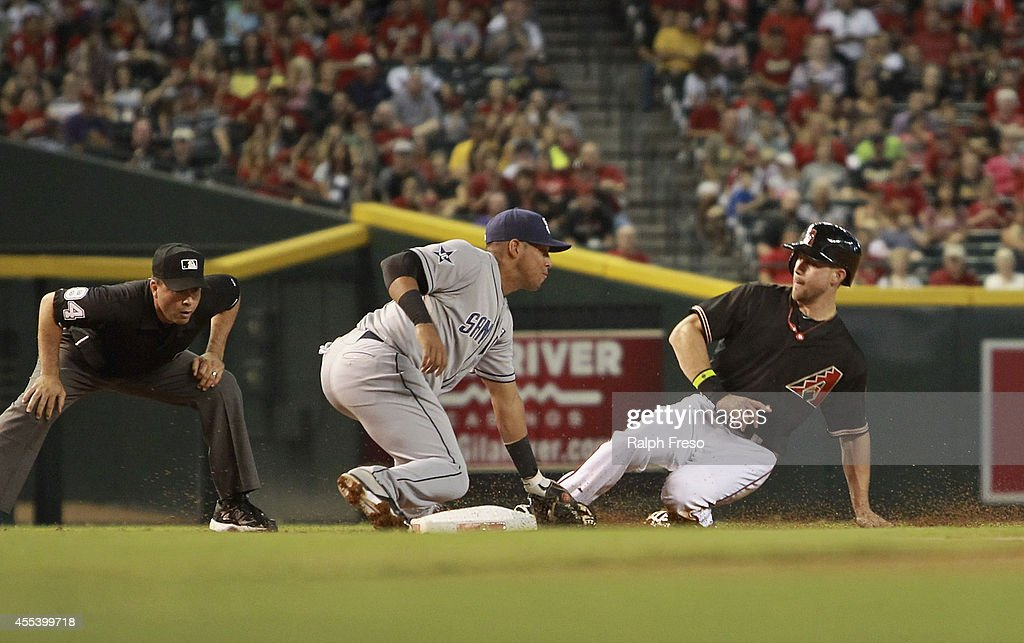 Ender Inciarte #5 of the Arizona Diamondbacks (R) slides into third just ahead of the tag by Yangervis Solarte #27 of the San Diego Padres as he steals the base during the first inning of a MLB game at Chase Field on September 13, 2014 in Phoenix, Arizona.