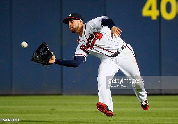 Ender Inciarte of the Atlanta Braves catches a fly ball hit by Ivan De Jesus Jr #3 of the Cincinnati Reds in the eighth inning at Turner Field on...