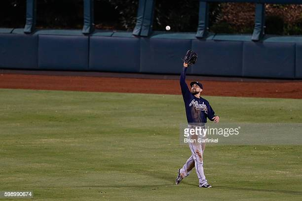 Ender Inciarte of the Atlanta Braves catches a long fly ball hit by Vince Velasquez of the Philadelphia Phillies in the third inning of the game at...