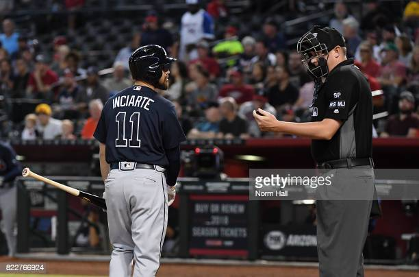 Ender Inciarte of the Atlanta Braves disagrees with a third strike call by home plate Chad Whitson ##62 during the first inning against the Arizona...