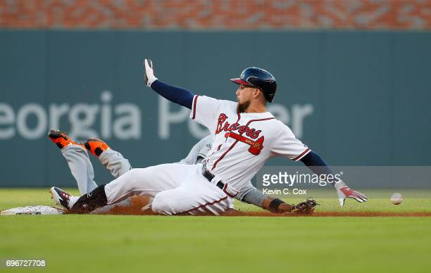 Ender Inciarte of the Atlanta Braves doubles as he slides safely into second base past Dee Gordon of the Miami Marlins in the first inning at...
