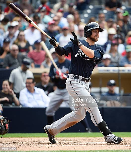 Ender Inciarte of the Atlanta Braves hits a triple during the sixth inning of a baseball game against the San Diego Padres at PETCO Park on June 8...