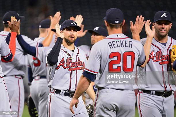 Ender Inciarte of the Atlanta Braves is congratulated by Anthony Recker after closing out the game against the Arizona Diamondbacks at Chase Field on...