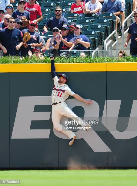 Ender Inciarte of the Atlanta Braves is unable to reach a first inning home run by Marcel Ozuna of the Miami Marlins at SunTrust Park on August 6...