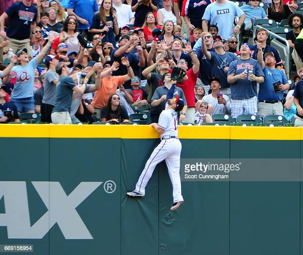 Ender Inciarte of the Atlanta Braves is unable to reach a second inning home run by Ryan Schimpf of the San Diego Padres at SunTrust Park on April 16...