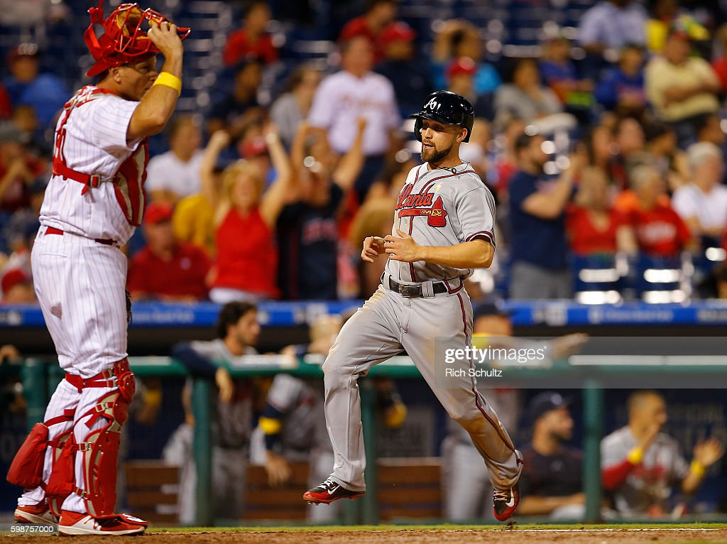 Ender Inciarte #11 of the Atlanta Braves scores on an RBI double by Freddie Freeman #5 as catcher A.J. Ellis #34 of the Philadelphia Phillies looks on during the ninth inning of a game at Citizens Bank Park on September 2, 2016 in Philadelphia, Pennsylvania.