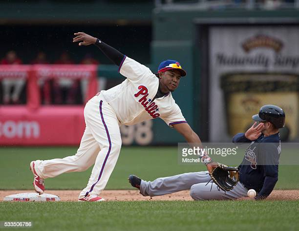 Ender Inciarte of the Atlanta Braves slides past Maikel Franco of the Philadelphia Phillies to steal second base in the top of the eighth inning at...