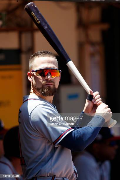 Ender Inciarte of the Atlanta Braves stands in the dugout during the third inning against the Oakland Athletics at the Oakland Coliseum on July 1...