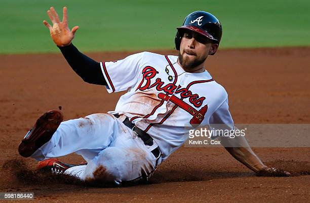 Ender Inciarte of the Atlanta Braves steals third base against the San Diego Padres in the first inning at Turner Field on August 31 2016 in Atlanta...