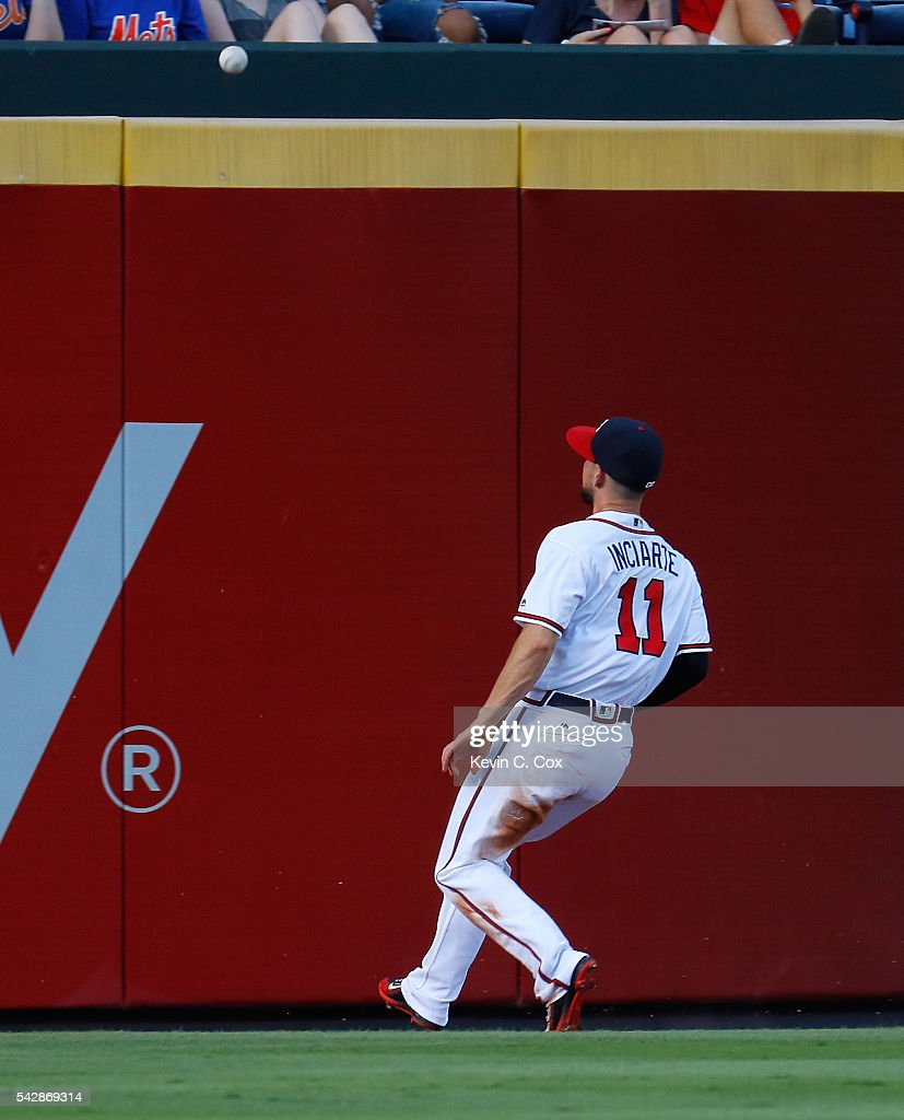 Ender Inciarte #11 of the Atlanta Braves watches a ground rule double hit by Wilmer Flores #4 of the New York Mets bounce over the outfield fence to allow Neil Walker #20 to score in the second inning at Turner Field on June 24, 2016 in Atlanta, Georgia.