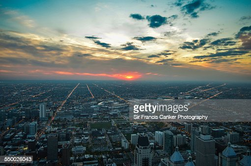 Endless aerial big city lights during sunset