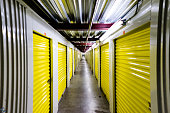 a state of the art self storage center hallway with yellow roll up doors