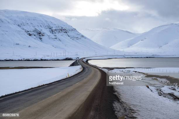 Endless mountain road through winter landscape Iceland