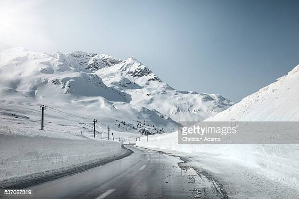 Endless mountain road through winter landscape