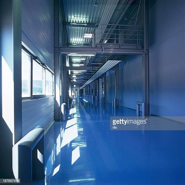 Endless  new industrial building floor in blue mood daylight
