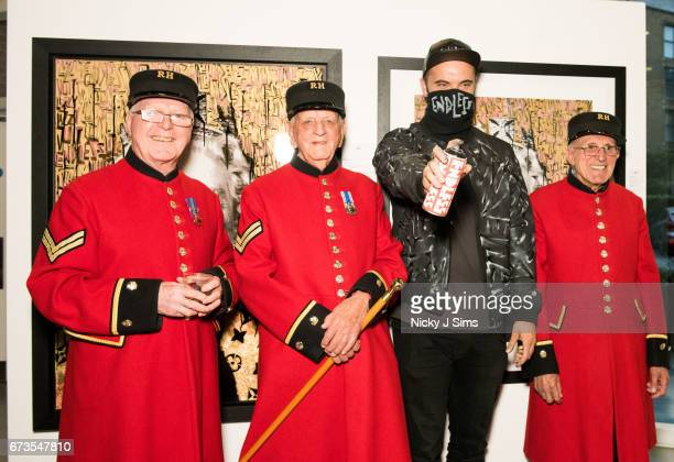 Endless poses for pictures with the Chelsea Pensioners at Endless The Royal Variety Adornments Exhibition Launch at Chelsea Waterside Artspace on...