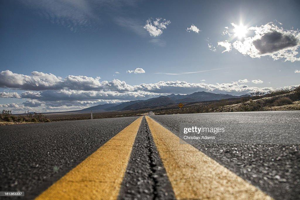 Endless, sunny desert road