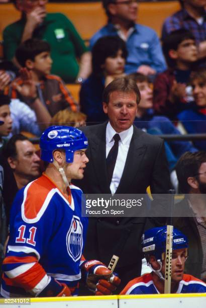 Endmonton Oilers coach Glen Sather observes the game from the bench