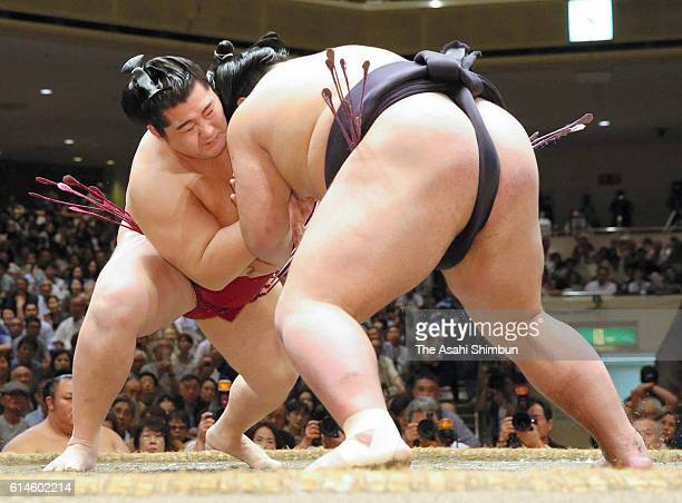 Endo pushes Nishikigi out of the ring to win during final day of the Grand Sumo Autumn Tournament at Ryogoku Kokugikan on September 25 2016 in Tokyo...