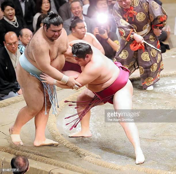 Endo pushes sekiwake Takayasu out of the ring to win during day fourteen of the Grand Sumo Autumn Tournament at Ryogoku Kokugikan on September 24...