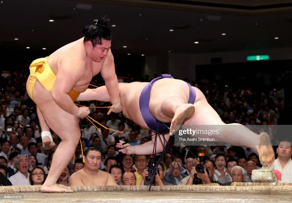 Endo (L) throws Yutakayama (R) to win during day four of the Grand Sumo Autumn Tournament at Ryogoku Kokugikan on September 13, 2017 in Tokyo, Japan.