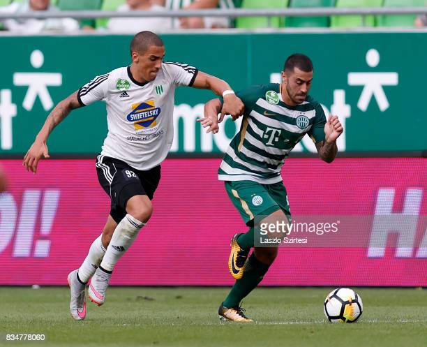 Endre Botka of Ferencvarosi TC competes for the ball with Myke Bouard Ramos of Swietelsky Haladas during the Hungarian OTP Bank Liga match between...