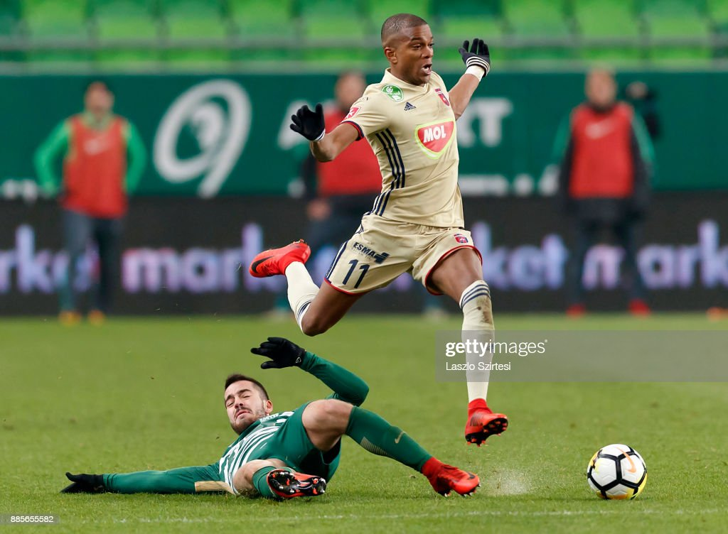 Endre Botka (L) of Ferencvarosi TC slide tackles Loic Nego #11 of Videoton FC during the Hungarian OTP Bank Liga match between Ferencvarosi TC and Videoton FC at Groupama Arena on December 2, 2017 in Budapest, Hungary.