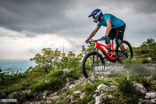 Enduro All Mountain E bike rider - adrenaline MTB trail above the city