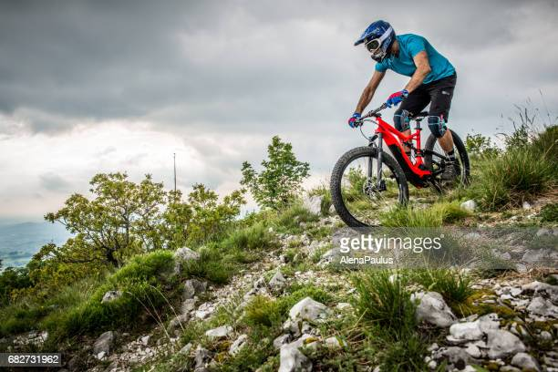 Enduro All Mountain E bike rider - adrenaline MTB trail above the city