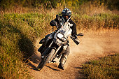 Enduro rider on track, strong grain added to create atmosphere.