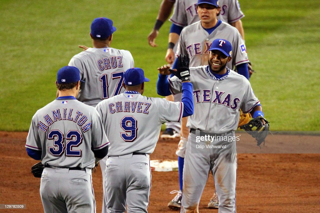 Endy Chavez #9 and Elvis Andrus #1 of the Texas Rangers celebrate after defeating the St. Louis Cardinals 2-1 during Game Two of the MLB World Series at Busch Stadium on October 20, 2011 in St Louis, Missouri.