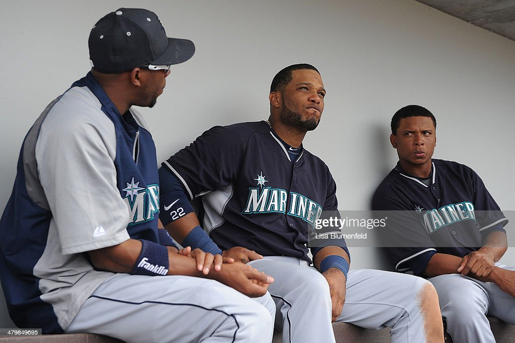 <a gi-track='captionPersonalityLinkClicked' href=/galleries/search?phrase=Endy+Chavez&family=editorial&specificpeople=216624 ng-click='$event.stopPropagation()'>Endy Chavez</a> #9 and <a gi-track='captionPersonalityLinkClicked' href=/galleries/search?phrase=Robinson+Cano&family=editorial&specificpeople=538362 ng-click='$event.stopPropagation()'>Robinson Cano</a> #22 of the Seattle Mariners sit in the dugout during the game against the Chicago Cubs at Cubs Park on March 20, 2014 in Mesa, Arizona.