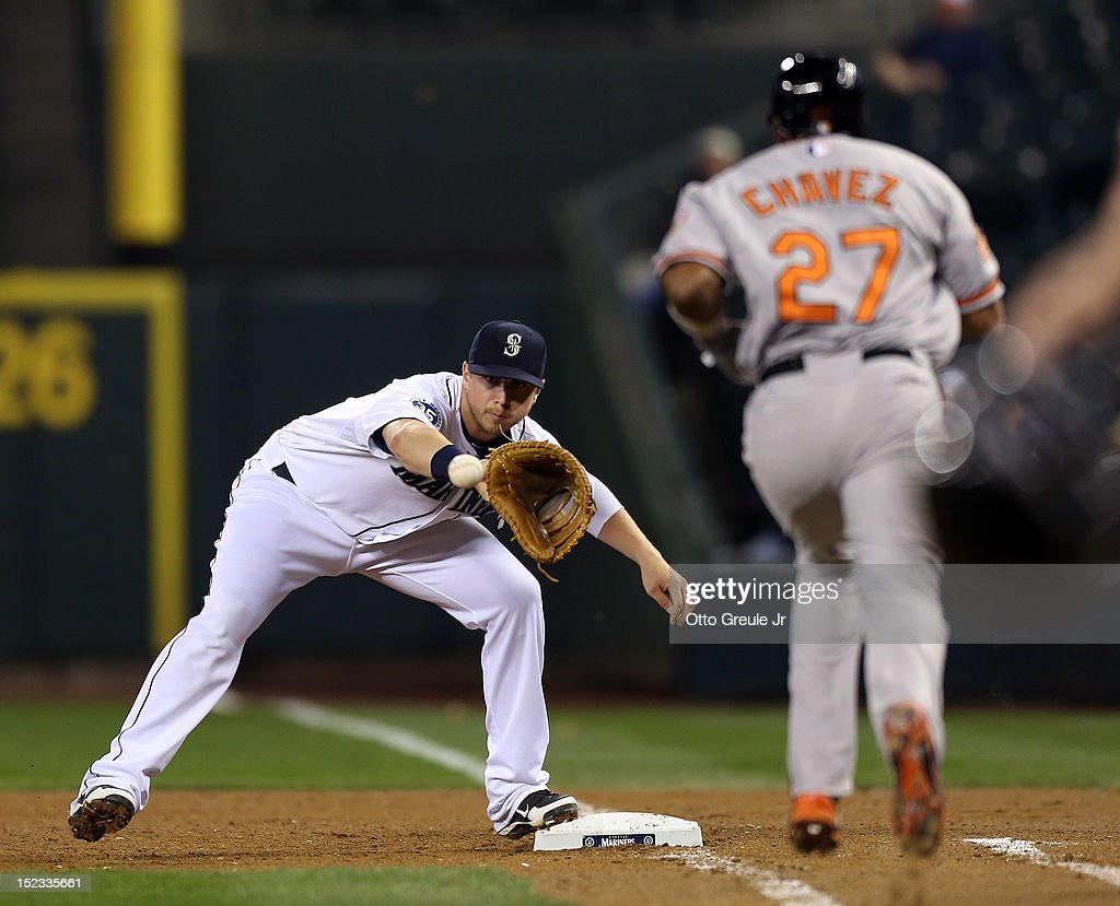 <a gi-track='captionPersonalityLinkClicked' href=/galleries/search?phrase=Endy+Chavez&family=editorial&specificpeople=216624 ng-click='$event.stopPropagation()'>Endy Chavez</a> #27 of the Baltimore Orioles is put out on a bunt play by first baseman <a gi-track='captionPersonalityLinkClicked' href=/galleries/search?phrase=Justin+Smoak&family=editorial&specificpeople=2350583 ng-click='$event.stopPropagation()'>Justin Smoak</a> #17 of the Seattle Mariners at Safeco Field on September 18, 2012 in Seattle, Washington.