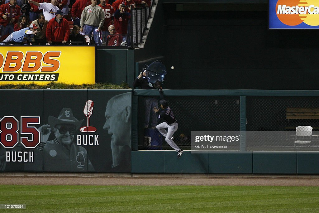 Endy Chavez of the Mets leaps but can't reach a home run by Cardinals starter Jeff Suppan during game 3 of the NLCS between the New York Mets and St. Louis Cardinals at Busch Stadium in St. Louis, Missouri on October 14, 2006. St. Louis won 5-0 to take a 2 games to 1 lead in the series.
