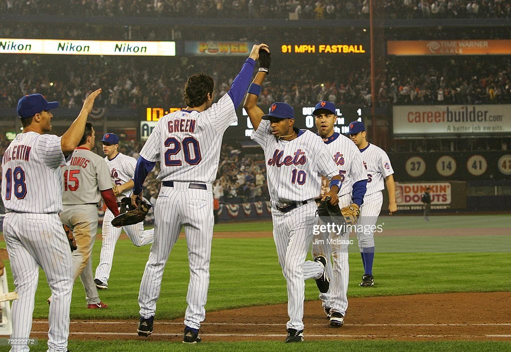 Endy Chavez of the New York Mets high fives Shawn Green after catching the final out of the sixth inning against the St Louis Cardinals during game...