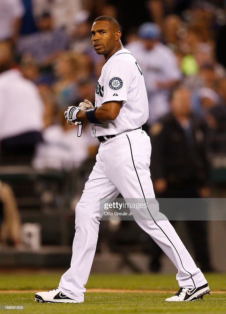 Endy Chavez #9 of the Seattle Mariners heads to his position in left field after striking out with the bases loaded to end the eighth inning against the Oakland Athletics at Safeco Field on May 11, 2013 in Seattle, Washington.