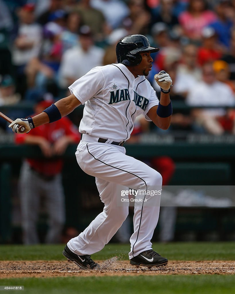 Endy Chavez #9 of the Seattle Mariners hits an RBI double in the eighth inning against the Washington Nationals at Safeco Field on August 31, 2014 in Seattle, Washington.