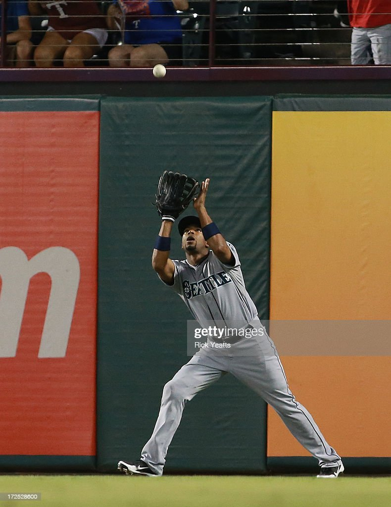 Endy Chavez #9 of the Seattle Mariners makes a catch on a fly ball hit by Mitch Moreland of the Texas Rangers (not pictured) in the eighth inning at Rangers Ballpark in Arlington on July 2, 2013 in Arlington, Texas.