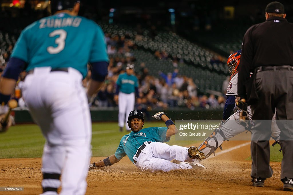 <a gi-track='captionPersonalityLinkClicked' href=/galleries/search?phrase=Endy+Chavez&family=editorial&specificpeople=216624 ng-click='$event.stopPropagation()'>Endy Chavez</a> #9 of the Seattle Mariners scores on an RBI single by Nick Franklin against catcher <a gi-track='captionPersonalityLinkClicked' href=/galleries/search?phrase=Carlos+Corporan&family=editorial&specificpeople=5716887 ng-click='$event.stopPropagation()'>Carlos Corporan</a> #22 of the Houston Astros in the eighth inning at Safeco Field on June 12, 2013 in Seattle, Washington.