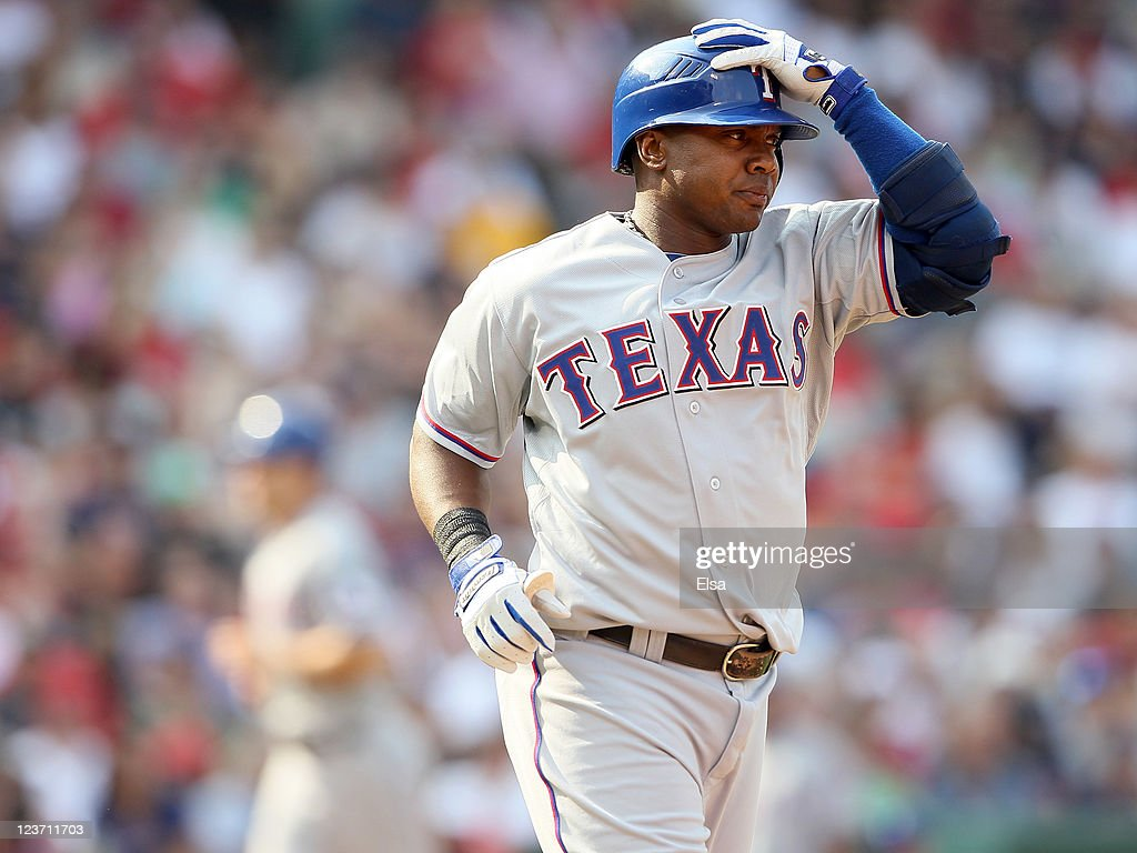 <a gi-track='captionPersonalityLinkClicked' href=/galleries/search?phrase=Endy+Chavez&family=editorial&specificpeople=216624 ng-click='$event.stopPropagation()'>Endy Chavez</a> #9 of the Texas Rangers is walked with the bases loaded to score teammate David Murphy in the sixth inning against the Boston Red Sox on September 4, 2011 at Fenway Park in Boston, Massachusetts.