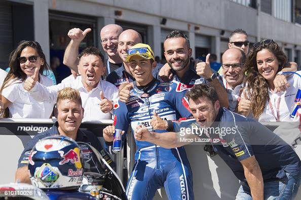 Enea Bastianini of Italy and Gresini Racing Moto3 celebrates with team the pole position at the end of the qualifying practice during the MotoGP of...