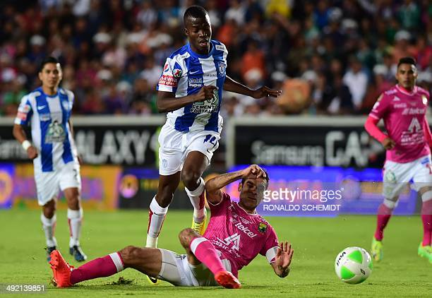 Ener Valencia of Pachuca vies for the ball with Rafael Marquez of Leon during their Mexican Apertura tournament final soccer match in Pachuca on May...